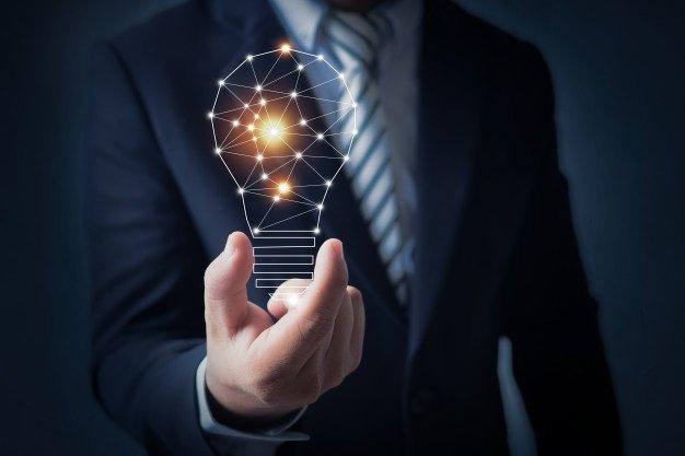 business-man-holding-bright-light-bulb-hand_28629-1091.jpg
